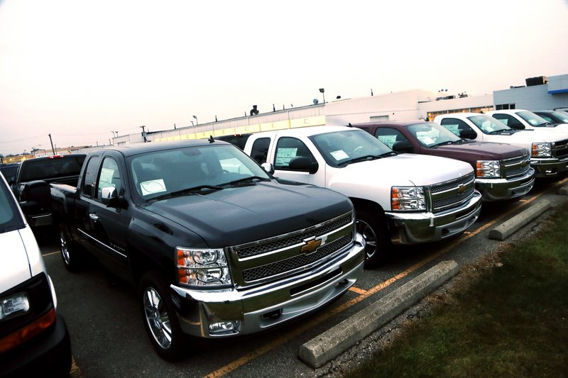 General Motors is offering generous deals to clear a growing inventory of Chevy and GMC pickup trucks, such as these Chevrolet Silverado pickups seen on a dealer's lot in Troy, Mich., on Monday.