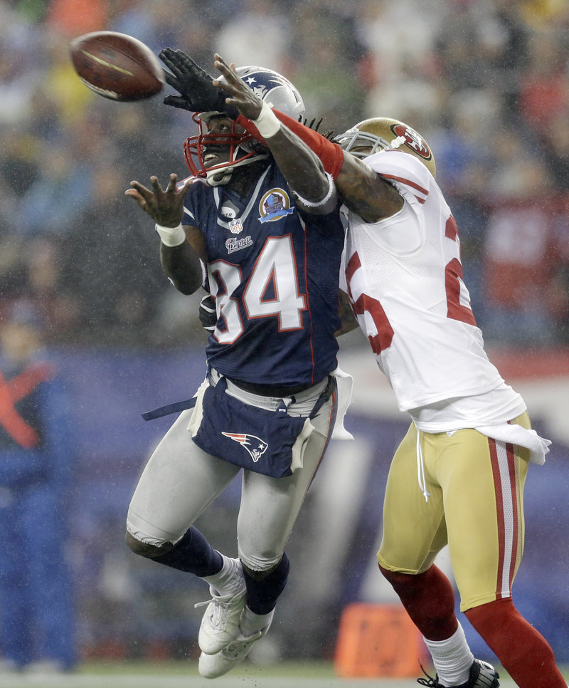 San Francisco cornerback Tarell Brown breaks up a pass in the end zone intended for Deion Branch during the Patriots' 41-34 loss Sunday night at Gillette Stadium.
