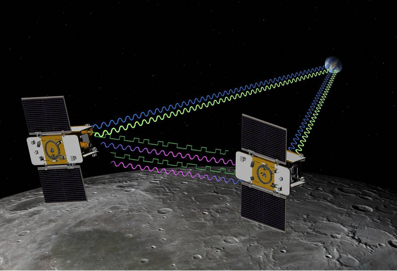 This artist's rendering shows the twin spacecraft Ebb and Flow orbiting the moon. The pair were crashed into the lunar surface Monday in a deliberate end to their mission.