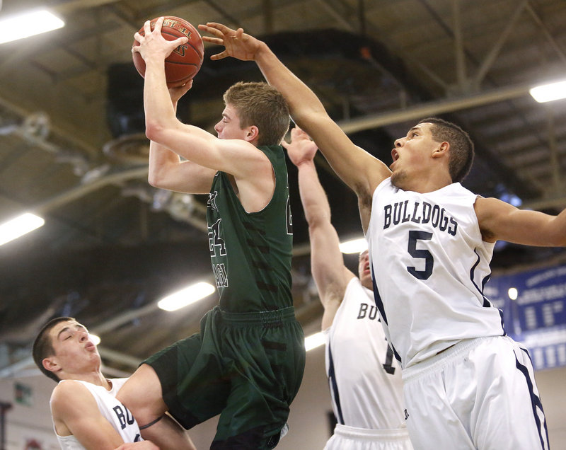 Justin Zukowski of Portland, left, holds his ground and takes a charge from Kyle Wright of Bonny Eagle during Portland's 55-52 victory Tuesday night at the Portland Expo. Matt Talbot of Portland goes for a blocked shot from behind.