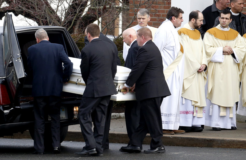 Pallbearers carry a casket out of St. Rose of Lima Roman Catholic Church on Tuesday after funeral services for Jessica Rekos, 6, who was among those killed when Adam Lanza walked into Sandy Hook Elementary School and opened fire.