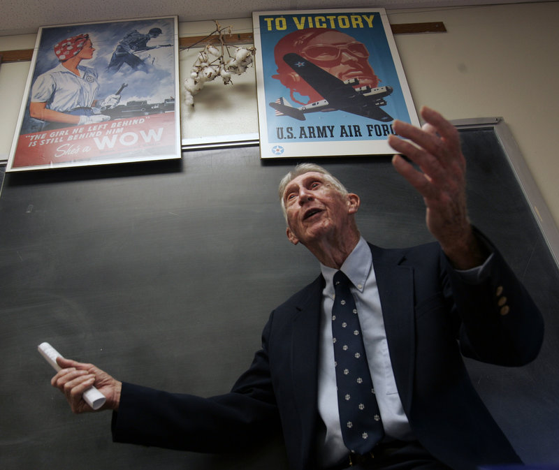 In this Sept. 13, 2007 file photo, Carrol Walsh talks to a history class at Hudson Falls High School in Hudson Falls, N.Y. The World War II combat veteran from New York, whose account of liberating Holocaust victims from a Nazi train led to reunions with the survivors 60 years later, has died. He was 91. (AP Photo/Mike Groll)