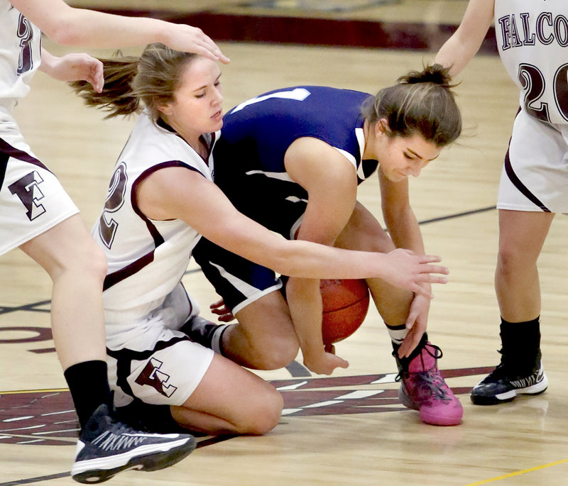 Jocelyn Davee, left, of Freeport and Ruby Cribby of York fight for a loose ball Thursday at Freeport. York improved to 6-0 but needed a second-half comeback to earn a 55-52 victory.