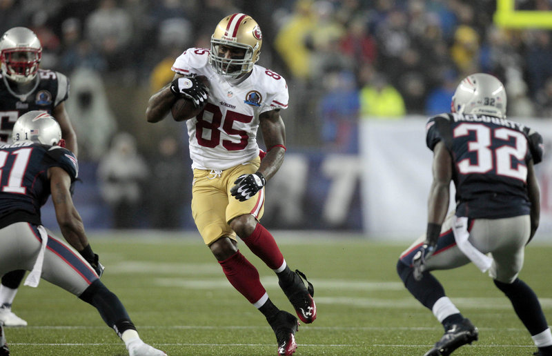 Vernon Davis, San Francisco tight end, finds himself surrounded by three New England defenders after catching a pass from quarterback Colin Kaepernick during last Sunday night's victory over the Patriots in Foxborough, Mass.