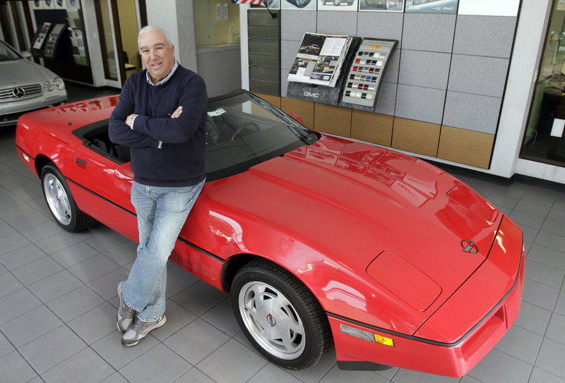 Corky Rice poses with a 1989 Corvette that authorities recovered in a self-storage facility. The car had been stolen in 1989 from a now defunct car dealership.