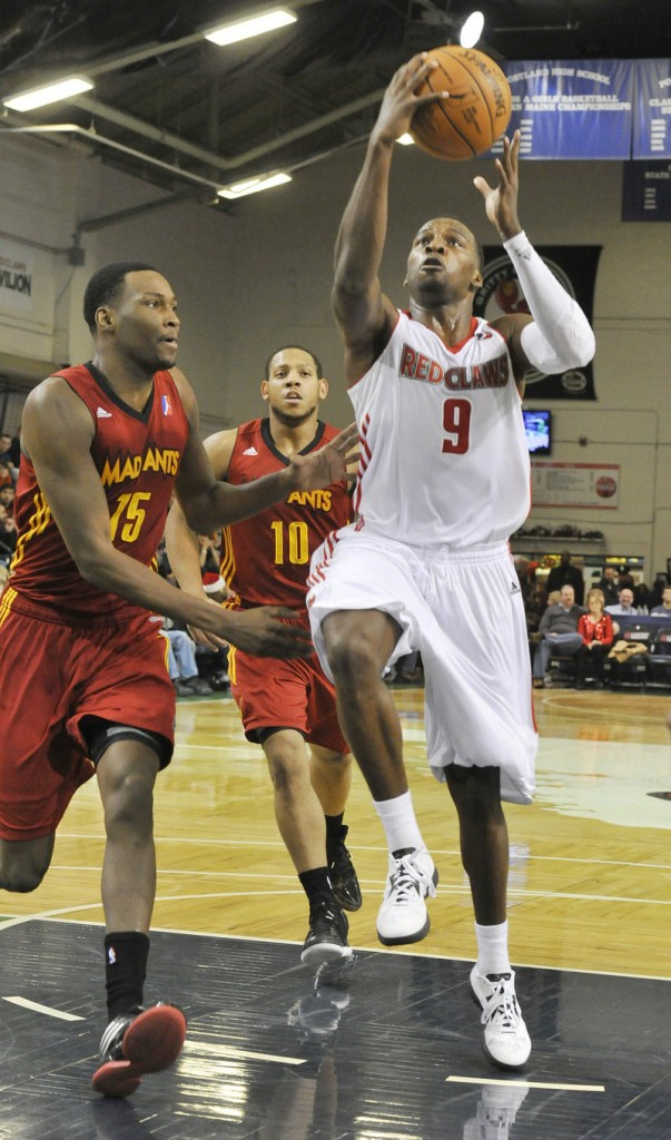Maine's Shelvin Mack drives down the lane against Fort Wayne's JaJuan Johnson, left, and Dairese Gary. Mack had 27 points and 12 assists as Maine improved to 4-0 against Fort Wayne this season.