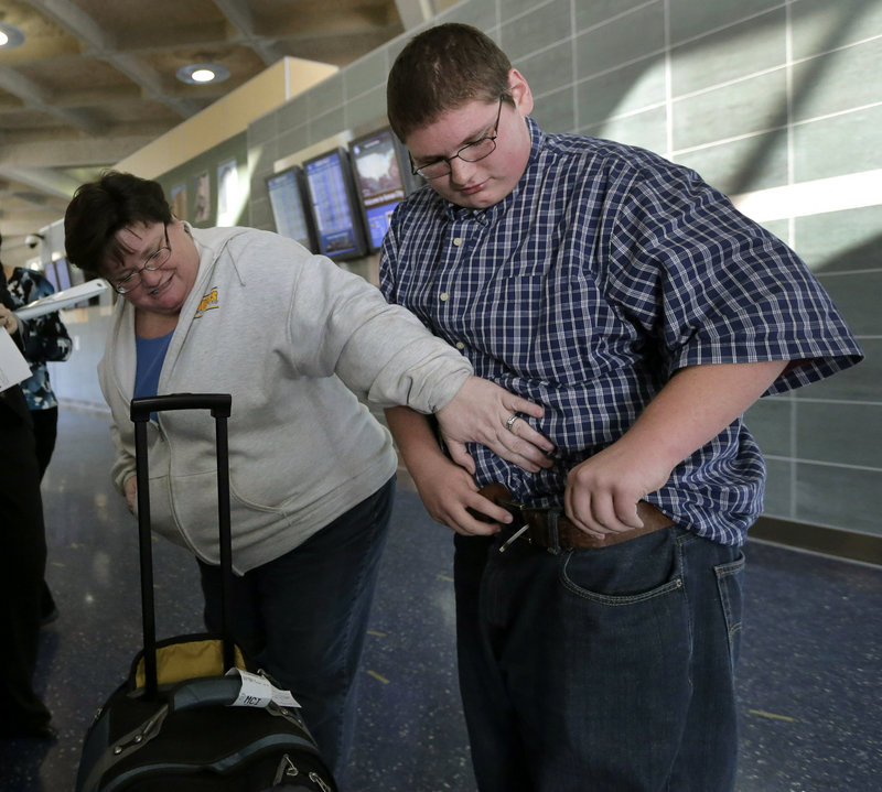 Debbie Alexander checks out her son Jason Alexander's baggy-fitting jeans after he returned Friday from a four-month stay at a weight-loss boarding school.
