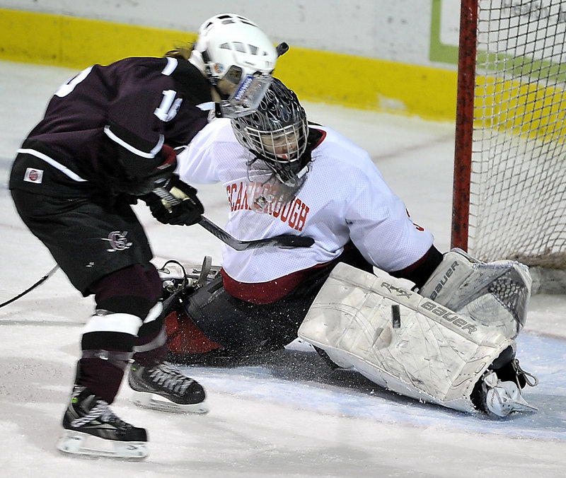 Scarborough goalie Devan Kane extends her left pad to stop a breakaway bid by Greely's Danita Storey during Saturday's game at the Cumberland County Civic Center. Kane made 38 saves in a 2-2 tie.