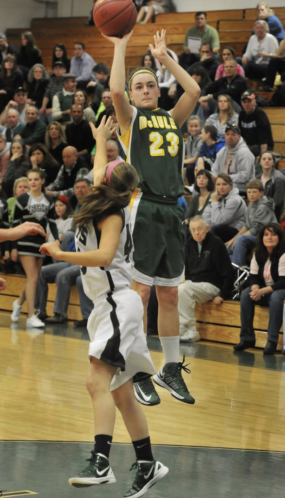 Allie Clement of McAuley shoots over Bonny Eagle's Cassidy Emery. Clement made three 3-pointers and scored 22 points.