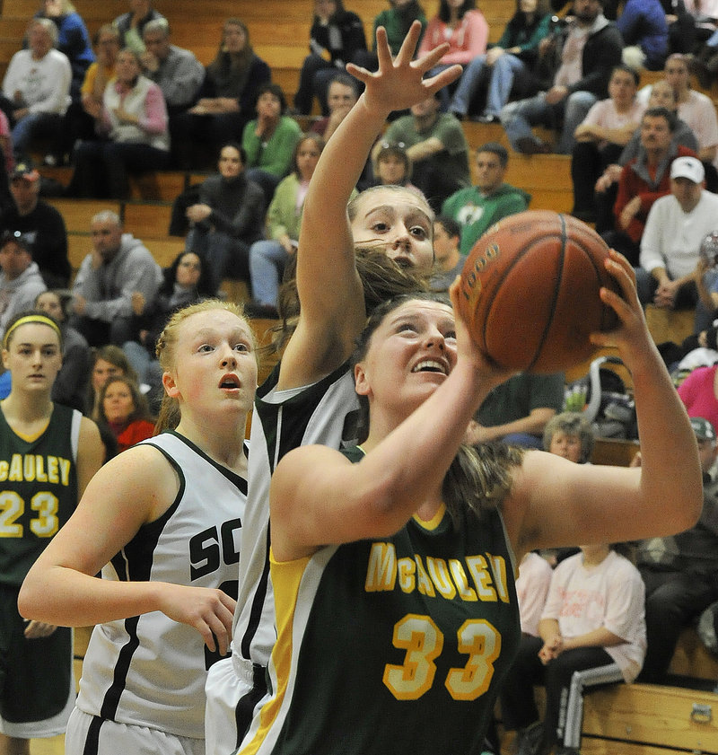Victoria Lux of McAuley gets inside the Bonny Eagle defense for a shot during Saturday's game in Standish. Lux scored 14 points as the Lions moved to 5-0 with a 71-41 victory.
