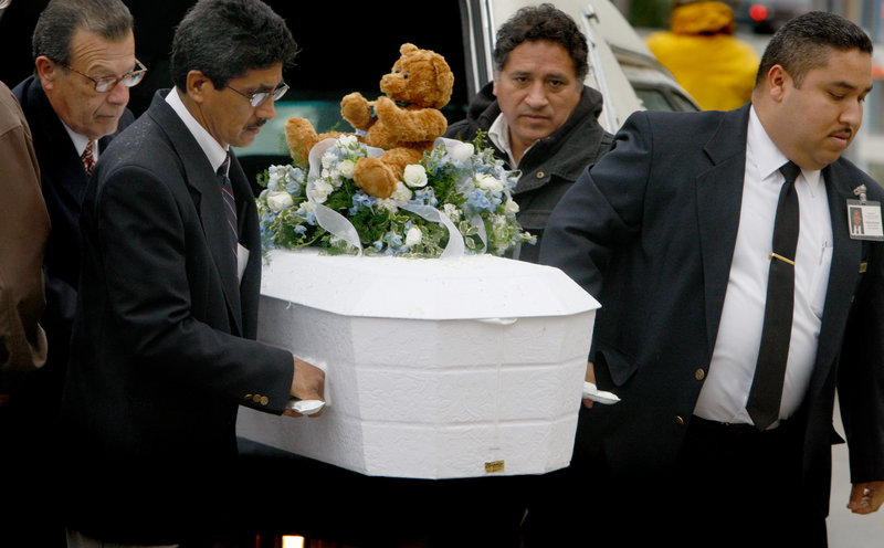 Pallbearers carry 4-year-old Roberto Lopez Jr.'s casket outside Our Lady of Angels Church in Los Angeles on Jan. 23, 2009. The boy was shot in the chest as he and his 5-year-old sister walked in a gang-plagued neighborhood. According to the Children's Defense Fund, 299 children under the age of 10 were killed by guns in 2008 and 2009.