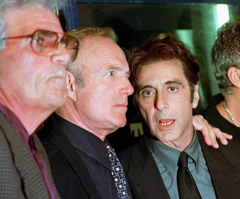 "Actors Al Pacino, right, James Caan, center, and Alex Rocco attend the 25th anniversary premiere of the movie of ""The Godfather"" in San Francisco in 1997."