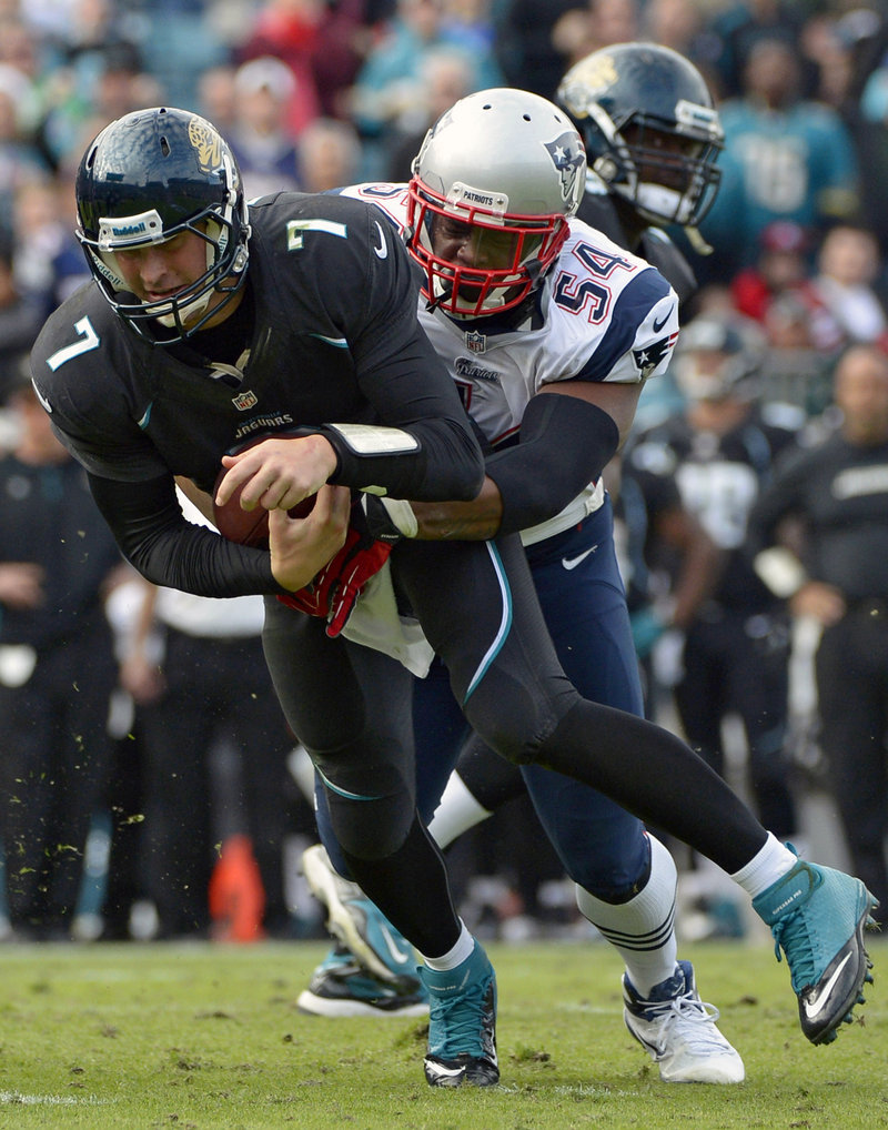 Jacksonville quarterback Chad Henne is wrapped up by New England's Dont'a Hightower in the Patriots' 23-16 win Sunday.