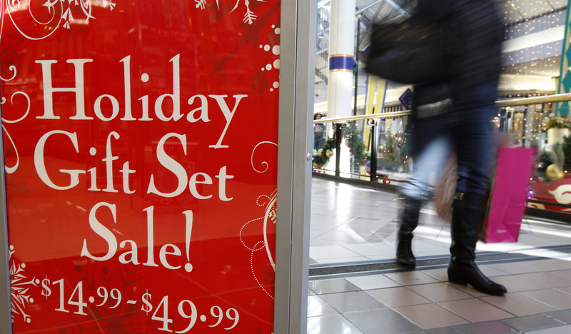 A store at the CambridgeSide Galleria mall in Cambridge, Mass., advertises a sale Monday. Early figures point to a ho-hum season for retailers despite efforts to lure shoppers over the weekend before Christmas.