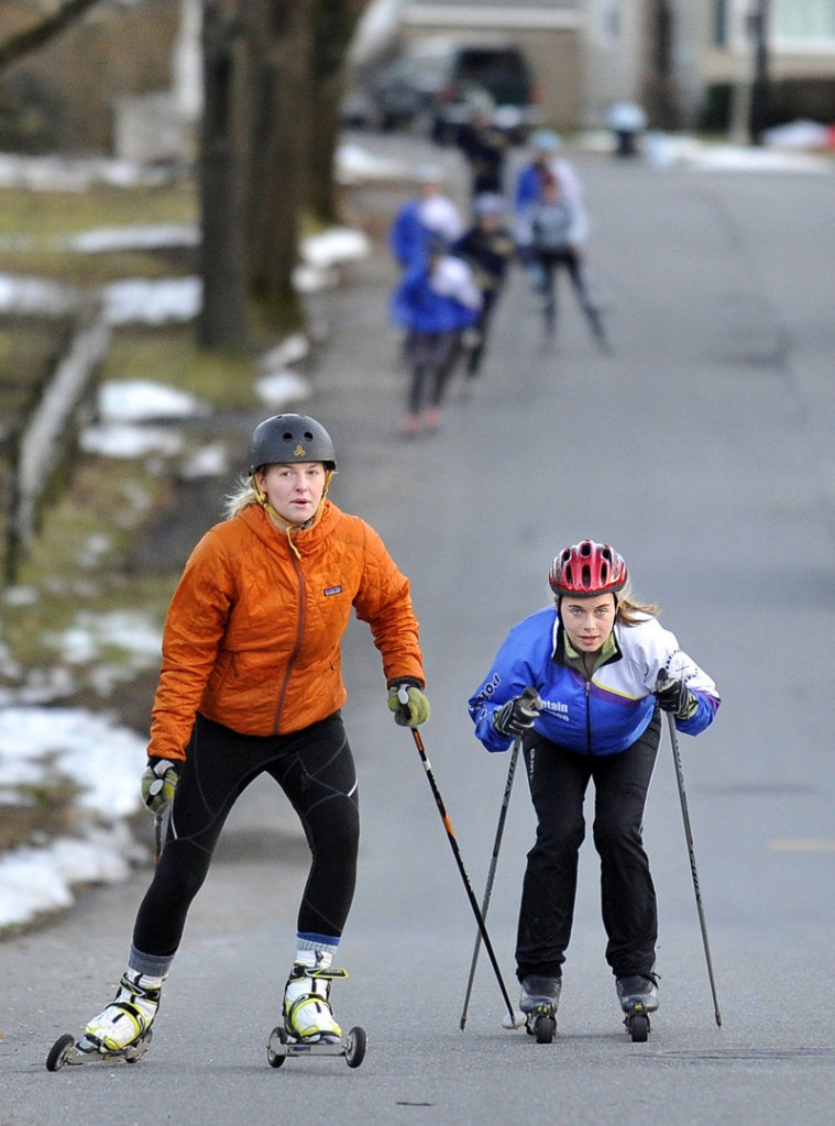 Sadie Sarvis, left, a senior at Casco Bay High, and Abby Popenoe, a senior at Portland High, have their sights on a state title while training with Portland Nordic, a local group.