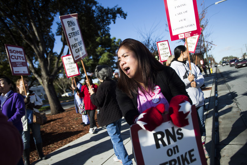 Yvette Grat, a nurse at Regional Medical Center of San Jose, takes part in a one-day strike Monday in San Jose, Calif. The protests were held at nine Bay area hospitals, which brought in replacement nurses.