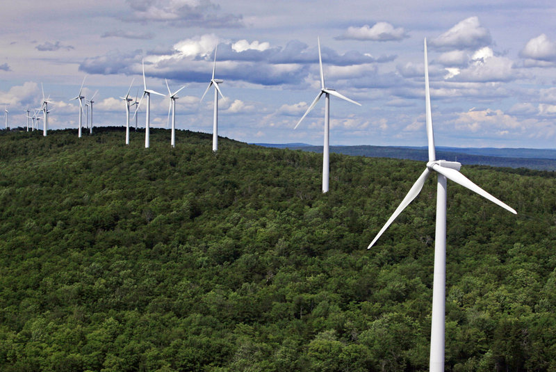 Wind turbines line a ridge on Stetson Mountain in Stetson. Maine is by far New England's largest wind producer but accounts for only a small fraction of total U.S. output.