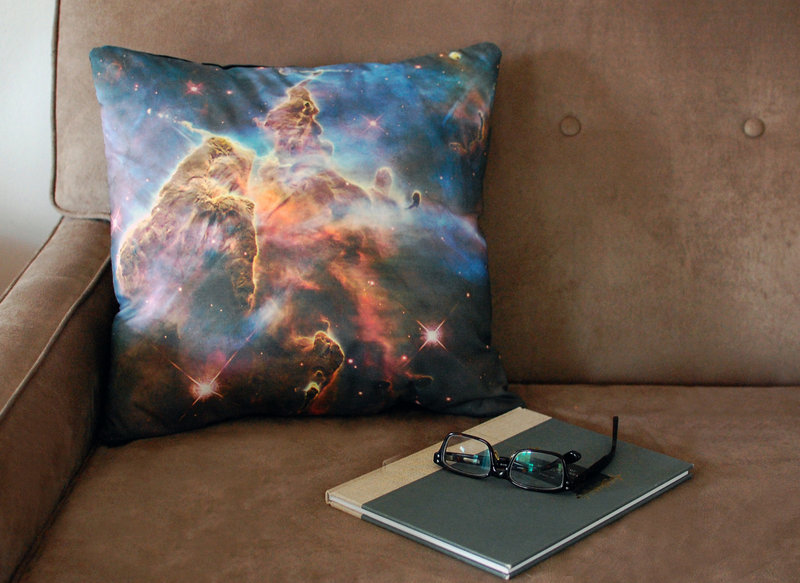 A Pillars of Creation pillow cover printed with an image from the Hubble telescope.