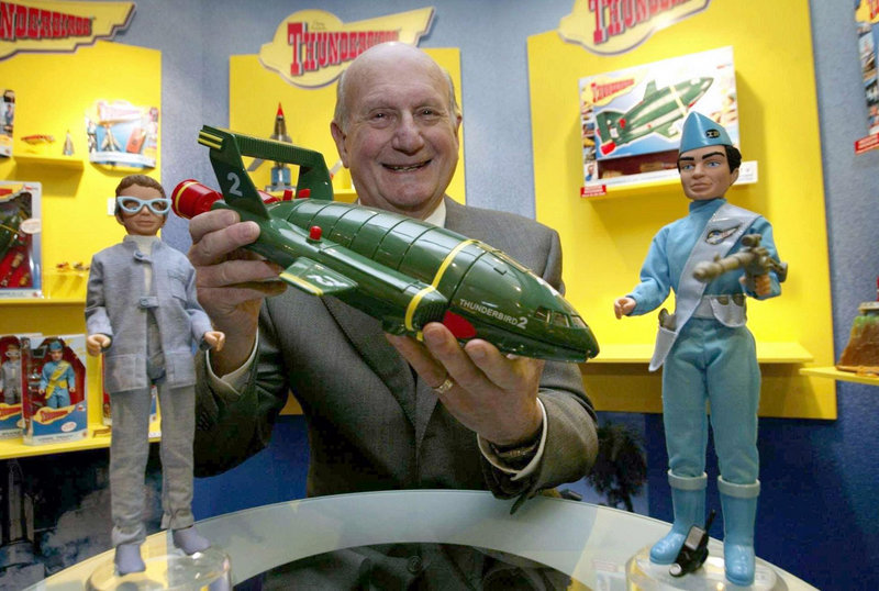 "Gerry Anderson poses with a toy Thunderbird 2 in London in 2005 on the 40th anniversary of the sci-fi hit ""Thunderbirds"" first TV broadcast."