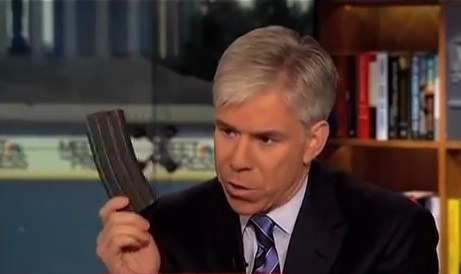 "David Gregory, the host of NBC's ""Meet the Press,"" holds what appears to be a high-capacity ammunition magazine on the show Sunday. Washington police are trying to decide whether he committed a crime."