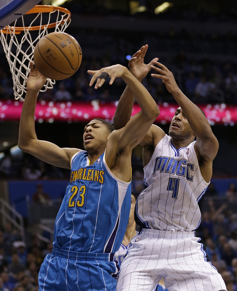 New Orleans' Anthony Davis, 23, and Orlando Magic's Arron Afflalo battle for a rebound during Wednesday's game in Orlando, won by the Hornets.