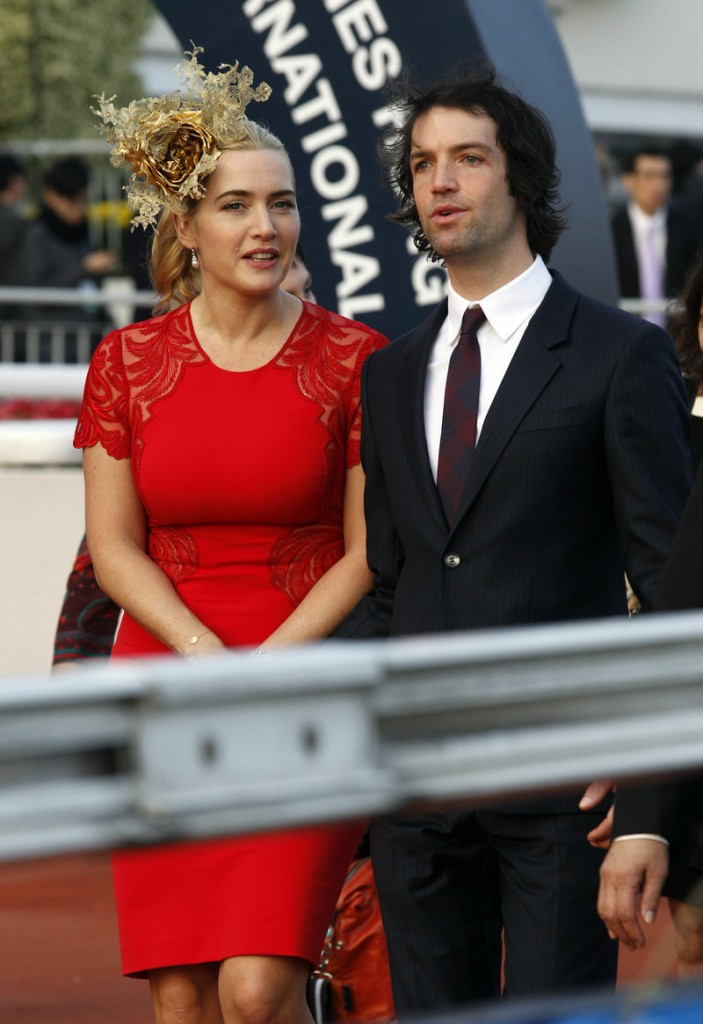British actress Kate Winslet arrives with her then-boyfriend Ned Rocknroll for an awards presentation Dec. 9 at a Hong Kong racetrack. The couple married recently in a private ceremony in New York City.