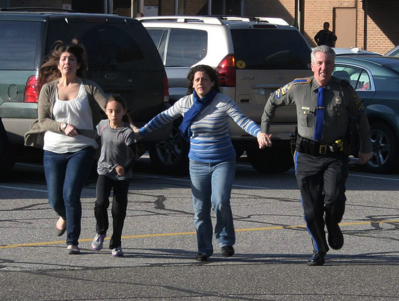 "A police officer leads two women and a child from Sandy Hook Elementary in Newtown, Conn., shortly after Adam Lanza opened fire there Dec. 14, killing 26 people. The expansion of gun rights shows that ""those who are equipped both with motivation and resources are likely to get their way,"" a reader says."