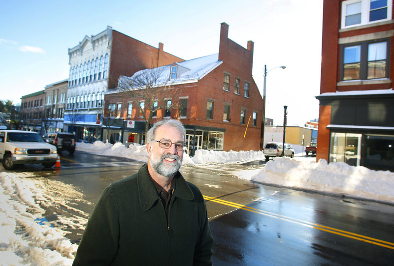 Biddeford Mayor Alan Casavant stands on Main Street in Biddeford on Friday. Casavant sees the closing of MERC this week as a turning point for the city after nearly three decades.