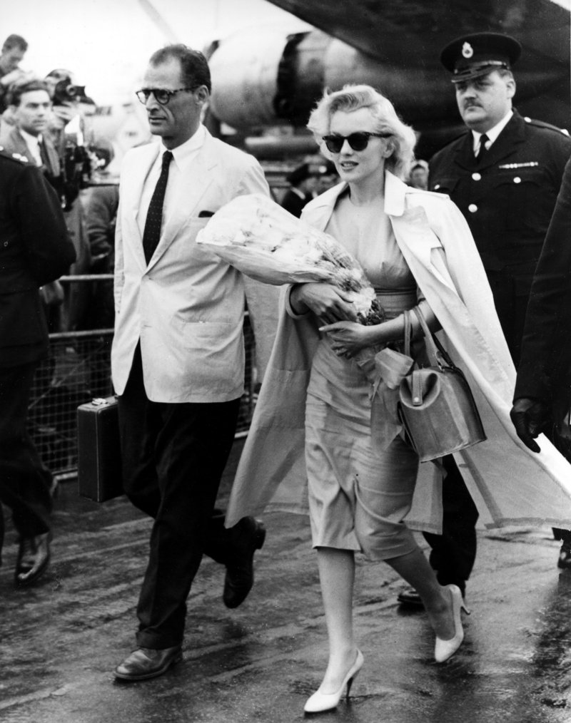 Marilyn Monroe and her husband, playwright Arthur Miller, arrive in London in 1956.