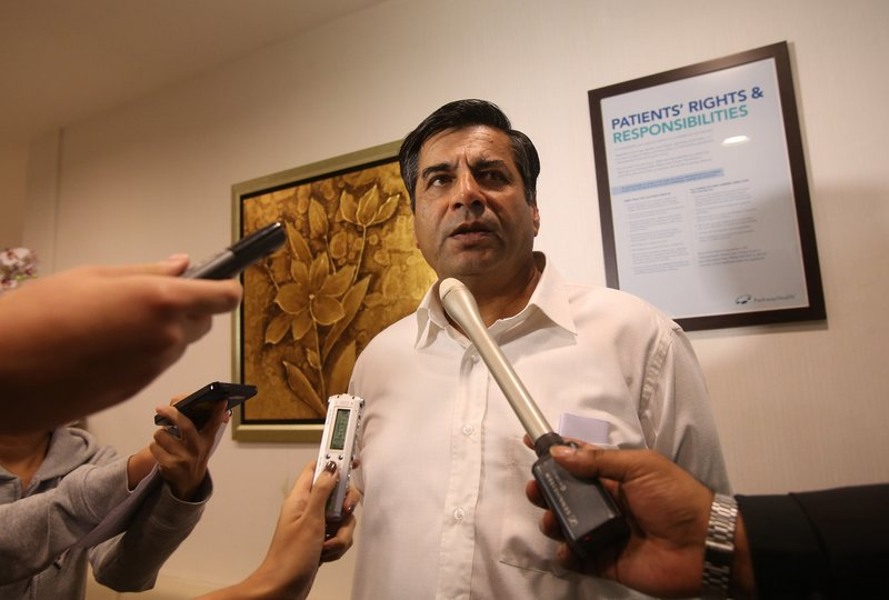 Indian High Commissioner to Singapore T.C.A. Raghavan speaks to reporters about the death of a young Indian woman at Mount Elizabeth Hospital in Singapore on Saturday. The woman had been gang-raped and severely beaten on a bus in New Delhi.