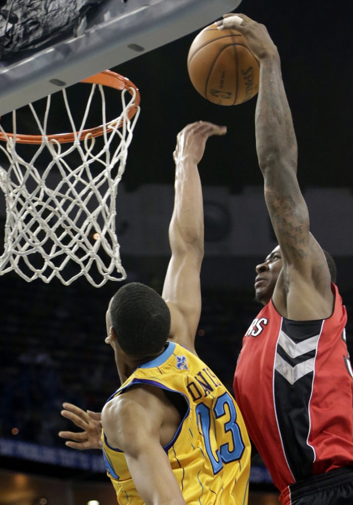 New Orleans power forward Anthony Davis (23) tries to block a shot by Toronto's Ed Davis during first-half action of Friday's game in New Orleans.