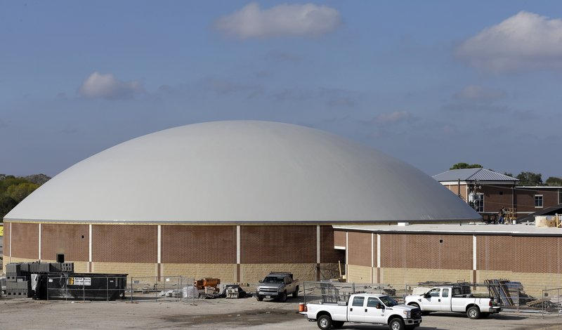 Work continues on the construction of a new domed gym at Edna High School in Edna, Texas. The hurricane dome is one of 28 such buildings planned to protect residents who might be unable to evacuate ahead of a hurricane.