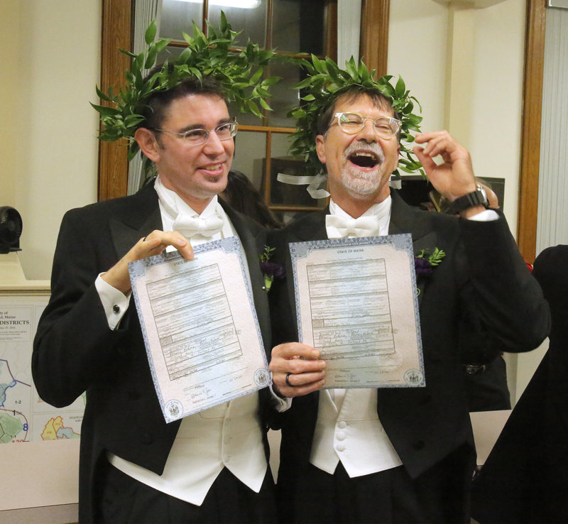 Jamous Lizotte, left, and Steven Jones display copies of their marriage license after they were wed Saturday in a ceremony at Portland City Hall.