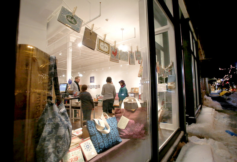 People visit and look at art in Engine, an arts-driven nonprofit, during the monthly Biddeford ArtWalk along Main Street in Biddeford on Friday.