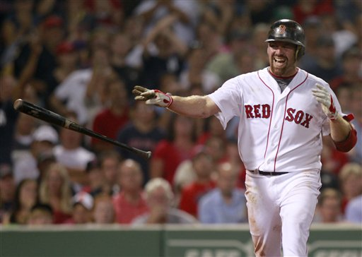 Boston Red Sox's Kevin Youkilis throws his bat after striking out to end the seventh inning of a baseball game against the New York Yankees in Boston, Sunday, Aug. 7, 2011. Youkilis has reportedly signed with the Yankees for a one-year, $12 million deal. (AP Photo/Michael Dwyer)