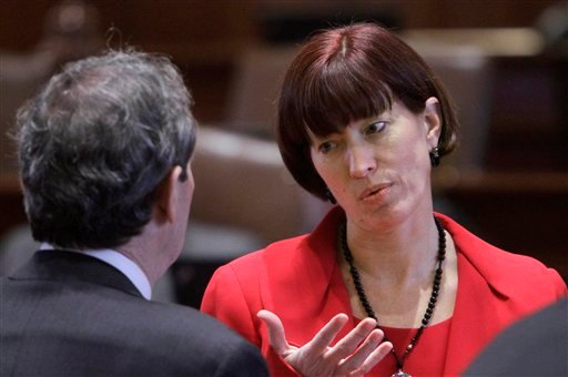 FILE - In this Feb. 8, 2012 file photo, Illinois Sen. Heather Steans, D-Chicago, right, confers with Illinois Senate President John Cullerton, D-Chicago, on the Senate floor during session at the Illinois State Capitol in Springfield, Ill. Advocates of legalized gay marriage in Illinois are pleased that Steans and state Rep. Greg Harris are planning to push for approval in January. Steans and Harris say they believe they have the votes necessary to fulfill Gov. Pat Quinn's hope of signing same-sex marriage into law in January. (AP Photo/Seth Perlman, File)