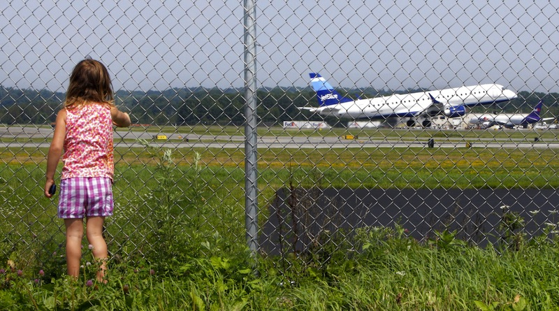 Hannah Jacob, 4, watches a JetBlue plane take off at the Portland International Jetport on Friday, August 19, 2011. Pending final accreditation, the University of Maine at Augusta will begin offering a bachelor's degree in aviation this fall, the university system announced on Monday, Jan. 28, 2012.