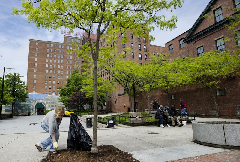 Dawn York of South Portland picks up trash in Congress Square Plaza on Tuesday, May 22, 2012. A City Council committee is scheduled to vote Wednesday, Jan. 23, 2012 whether Congress Square Park will remain a park, or be sold to the Eastland Hotel and become a ballroom.