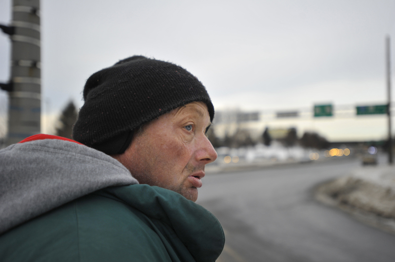 The 55-year-old homeless man checks for traffic before crossing a street on his way to the Portland Housing Authority.