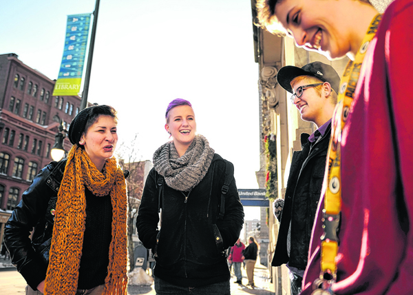 A group of friends, left to right, Elizabeth Sines, River Lenard, Dex Robbins and Logan Cooper, smoke together outside the Portland Public Library on Monday. They say they are against a proposed smoking ban in Monument Square.