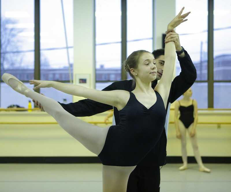 Instructor Joseph Morrissey works with Vanessa Van Deusen, a junior at Waynflete, during a CORPS practice at Portland Ballet.