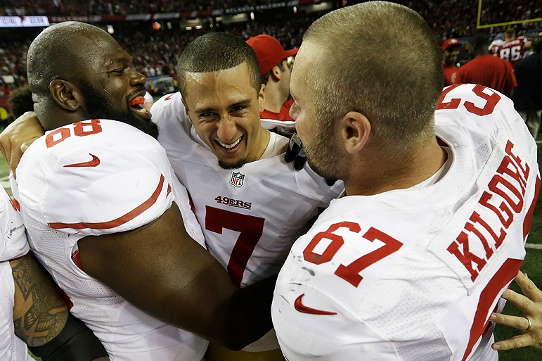 San Francisco quarterback Colin Kaepernick, center, celebrates with linemen Leonard Davis, left, and Daniel Kilgore after leading the 49ers to a 28-24 win over the Atlanta Falcons in the NFC championship game. The 49ers are headed to the Super Bowl for the first time in 18 years.