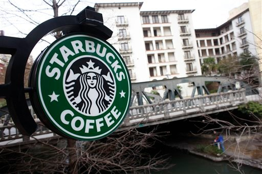 A sign outside a Starbucks hangs over the Riverwalk in San Antonio, Texas, in a 2010 file photo.