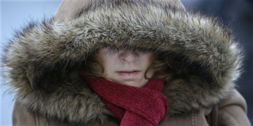 A Commuter bundles up against extreme cold conditions Tuesday, Jan. 22, 2013, in Chicago.Maine Gov. Paul LePage has declared a limited emergency to allow heating oil truck drivers to work extra hours to ensure timely deliveries during a period of extreme cold. (AP Photo/M. Spencer Green)