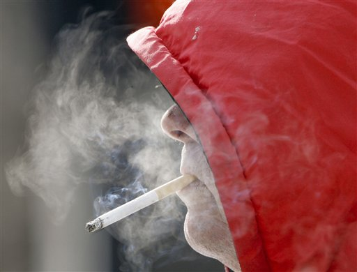 In this 2007 file photo, Omaha resident Charlie Waters has a cigarette. The American Lung Association of the Northeast is calling for a $1.50-per-pack increase in the cigarette excise tax in Maine to encourage smokers to quit and deter others from picking up the unhealthy habit. (AP Photo/Nati Harnik)
