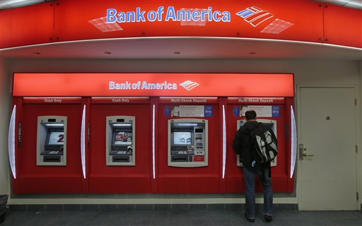 In this Dec. 13, 2012 photo, a customer stops at a Bank of America ATM office in Boston. Bank of America Corp. says it will spend more than $10 billion to settle mortgage claims resulting from the housing meltdown. Under the deal announced Monday, Jan. 7, 2013, the bank will pay $3.6 billion to Fannie Mae and buy back $6.75 billion in loans that the North Carolina-based bank and its Countrywide banking unit sold to the government agency from Jan. 1, 2000 through Dec. 31, 2008. That includes about 30,000 loans. (AP Photo/Charles Krupa)