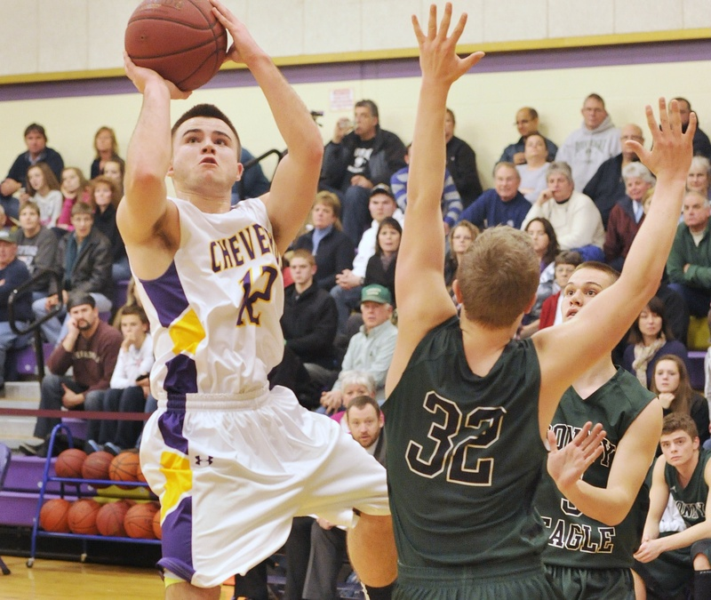 Brad Carney, who led Cheverus with 16 points, including four 3-pointers, puts up a shot Wednesday night over C.J. Autry of Bonny Eagle during Bonny Eagle's 69-48 victory. The Scots improved to 6-1; the Stags fell to 3-4.