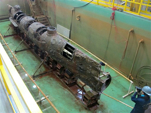 The Confederate submarine H.L. Hunley sits in a conservation tank in North Charleston, S.C. Scientists say a pole on the front of the sub designed to plant explosives on enemy ships may hold a key clue to its sinking during the Civil War.