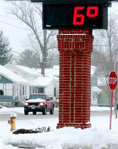 The thermometer on the Andover Bank in Austinburg Township in Ohio shows a temperature of 6 degrees Tuesday afternoon.