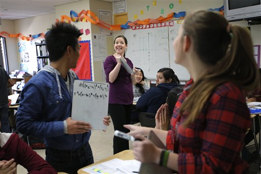"""Teacher Crystal Kirch, center, talks to her students in her pre-calculus class at Segerstrom High School in Santa Ana, Calif., recently. A growing number of teachers are implementing what is known as """"flipped learning."""""""